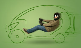Man drives an eco friendy electric hand drawn car Stock Photos
