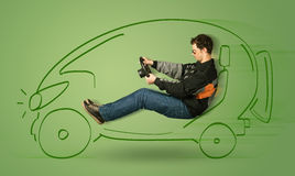 Man drives an eco friendy electric hand drawn car Royalty Free Stock Images