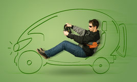 Man drives an eco friendy electric hand drawn car. Concept Royalty Free Stock Image