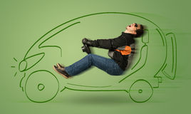 Man drives an eco friendy electric hand drawn car. Concept Royalty Free Stock Photography