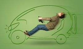 Man drives an eco friendy electric hand drawn car. Concept Stock Images