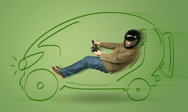 Man drives an eco friendy electric hand drawn car Stock Photography