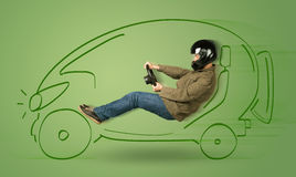 Man drives an eco friendy electric hand drawn car Royalty Free Stock Photos