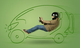 Man drives an eco friendy electric hand drawn car. Concept Royalty Free Stock Photo