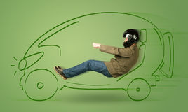 Man drives an eco friendy electric hand drawn car. Concept Stock Image