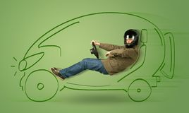 Man drives an eco friendy electric hand drawn car. Concept Royalty Free Stock Images
