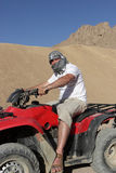 Man drives Quad Bike Stock Images