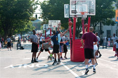 Man Drives And Shoots Layup In Street Basketball Tournament. Athens, GA, USA - August 24, 2013:  A man shoots a layup in a 3-on-3 basketball tournament held on Royalty Free Stock Images