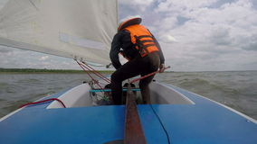 Man drives sports yacht. Sail sport stock footage