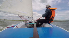 Man drives sports yacht. Sail sport stock video footage