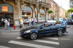 Man driving beautiful Volvo C70 Convertible car in beautiful ci Stock Photos