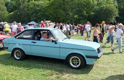 A man driving in a blue mk 2 ford escort rs2000 at the Annual Hebden Bridge Vintage Weekend Vehicle Show. Hebden Bridge, West Yorkshire, England - August 4 2018 royalty free stock image