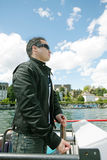 Man driving a boat in a beautiful landscape Royalty Free Stock Photo