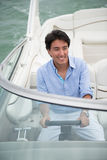 Man driving a boat Royalty Free Stock Photos