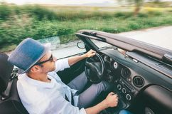 Man driving cabriolet car by province mountain road top view imaage royalty free stock photo