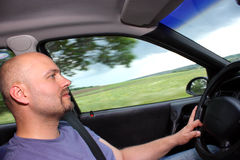 A man driving a car. Inside view with blur movement  on window close up Stock Photography