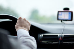 Man driving a car. With his hands on the steering wheel Royalty Free Stock Photos