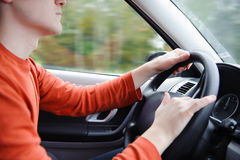 Man driving car. Young serious man driving a car. Two hands on a steering wheel Royalty Free Stock Photos