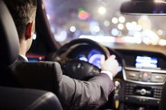 Man driving car. Man driving a car at night stock photo