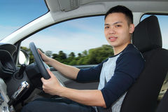 Man driving car. A young man driving a car Stock Photography