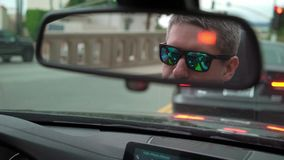 Man driving car. In a city stock footage