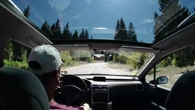 Man driving a car on country road stock video footage