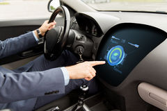 Man driving car with eco mode on board computer Stock Images