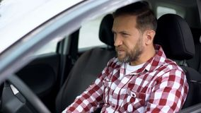 Man driving car, eyesight problems, poor vision, tiring journey, accident risk. Stock photo royalty free stock images