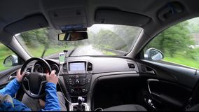 Man driving a car with gps navigation. System and phone smart phone app stock footage