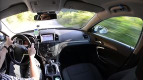 Man driving a car with gps navigation system stock video footage