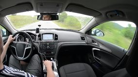 Man driving a car with gps navigation system stock video