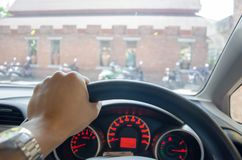 Hands grip the steering wheel. Man driving car, hand hold steering wheel Royalty Free Stock Photo