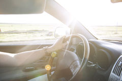 Man driving car. Hand in the wheel Royalty Free Stock Images