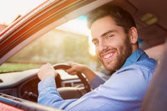 Man driving a car Stock Images