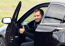 Man driving a car. Happy man driving a car in the summer Royalty Free Stock Photography