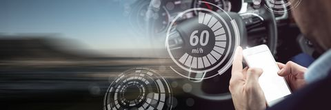 Man driving in car with heads up display interface and phone and motion transition. Digital composite of Man driving in car with heads up display interface and royalty free stock images