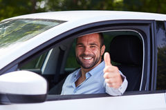 Man driving car. Man driving his car and makes gesture with thumb up royalty free stock photo