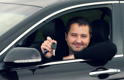 A man driving a car. With keys in hand Royalty Free Stock Photography