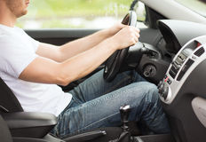 Man driving the car with manual gearbox Stock Photos