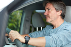 Man driving car. Mature man driving car. Road security concept Royalty Free Stock Photography