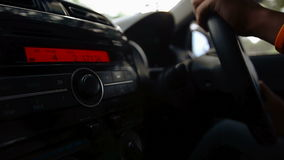 Man driving car with nature sun flare and traffic shake. Man driving a car with nature sun flare and traffic shake stock footage