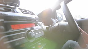 Man driving car with nature sun flare and traffic shake. Man driving a car with nature sun flare and traffic shake stock video footage
