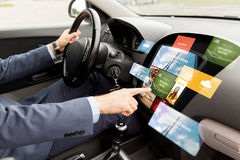 Man driving car with news on board computer Royalty Free Stock Photos