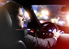 Man driving a car at night Stock Images
