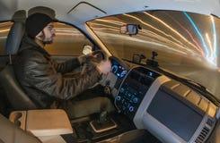 Man driving car at night Stock Photo