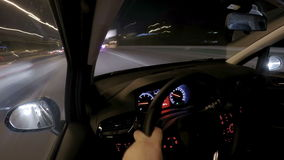 Man driving car at night timelapse stock video