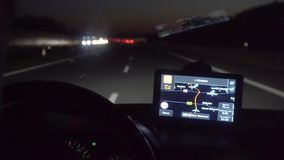 A Man Driving a car on the Overpass Turning. Inside view. Evening-night time, real time capture. Wide angle stock footage