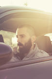 Man driving a car. Retro colors Stock Photo