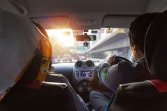 A man driving in car on the road. view from rear. At the sunset Royalty Free Stock Photos
