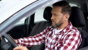 Man driving car with seat belt not fastened, safety on road, accident risk. Stock photo royalty free stock photo
